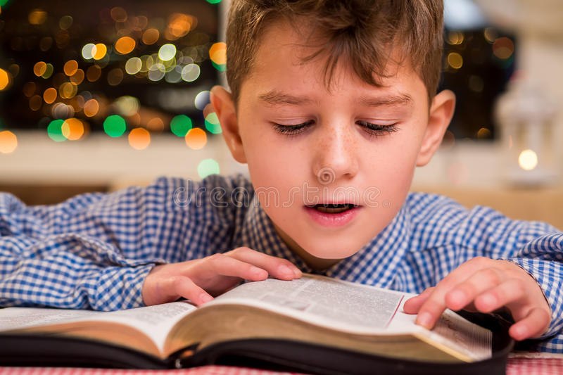 Kid reading book out loud. stock photos