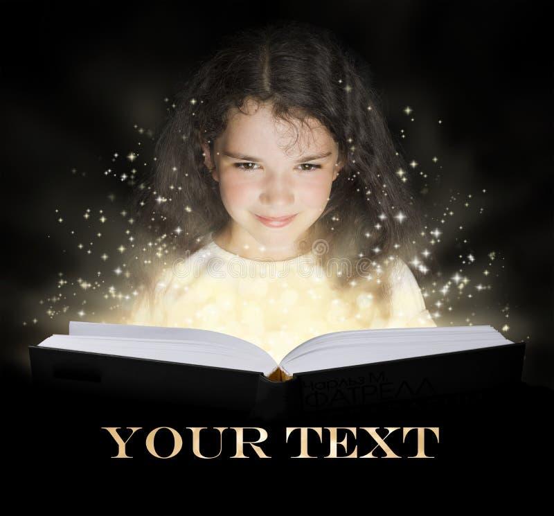 Kid reading the magic book.  stock image