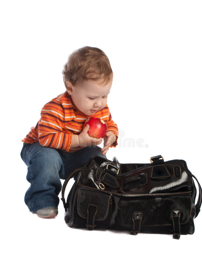 Download Kid With Red Apple, Sitting Near A Bag, Isolated Stock Photo - Image: 6945732