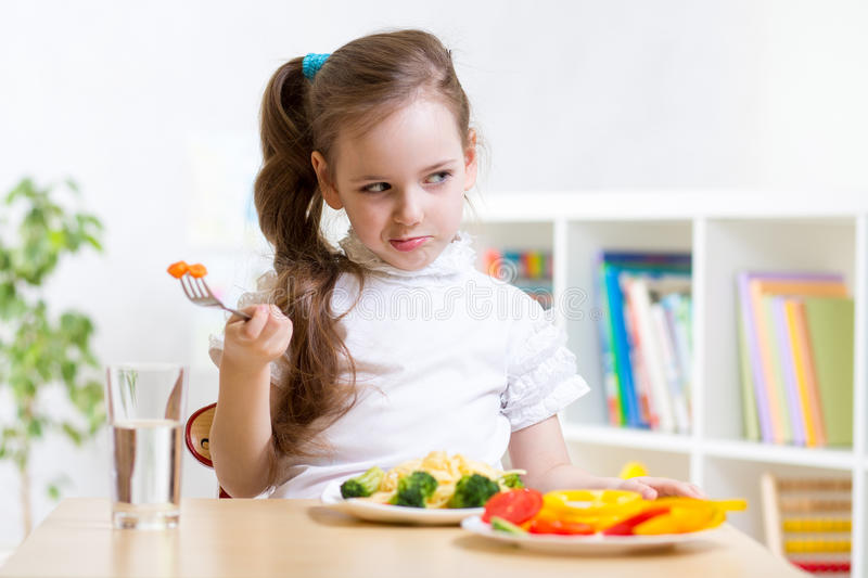 Kid refusing to eat his dinner royalty free stock photography