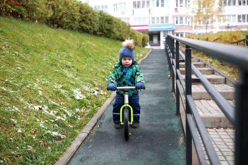 Kid riding on balance bike royalty free stock image