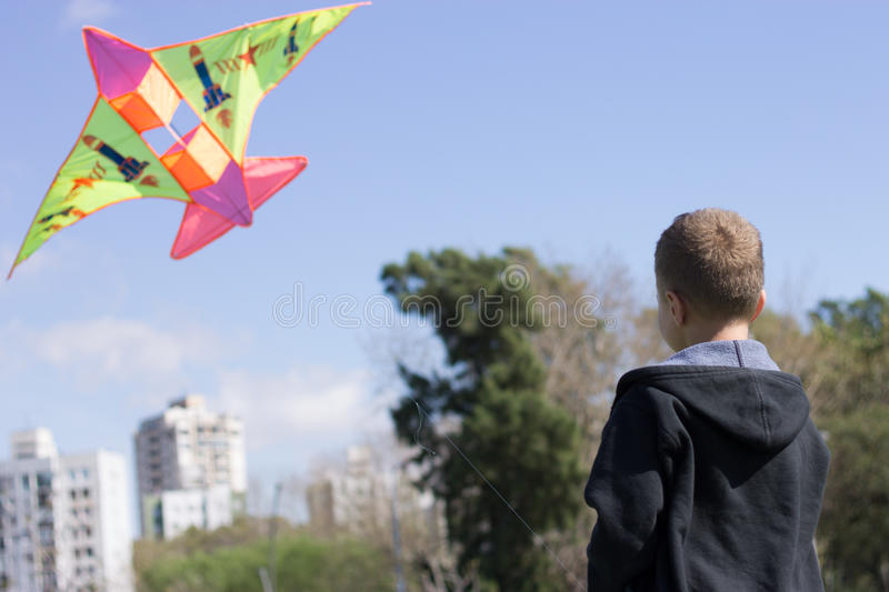 Kid riding a Kite royalty free stock photography