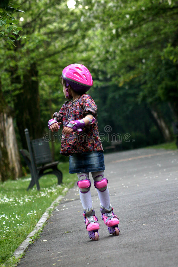 Kid rollerskating. In the park royalty free stock images