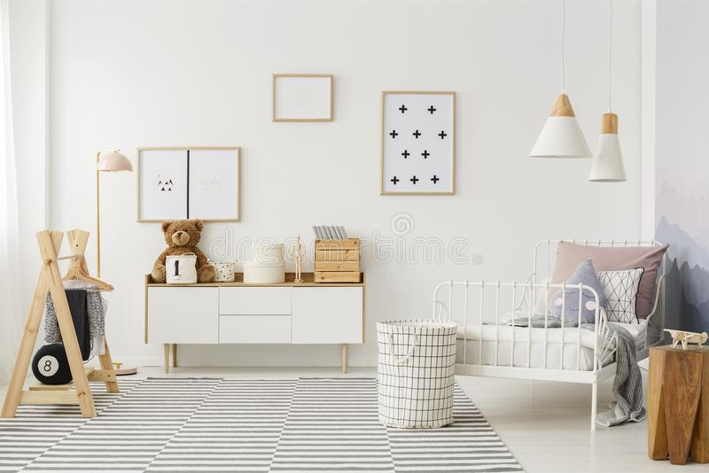 Kid`s bedroom with wooden furniture stock image