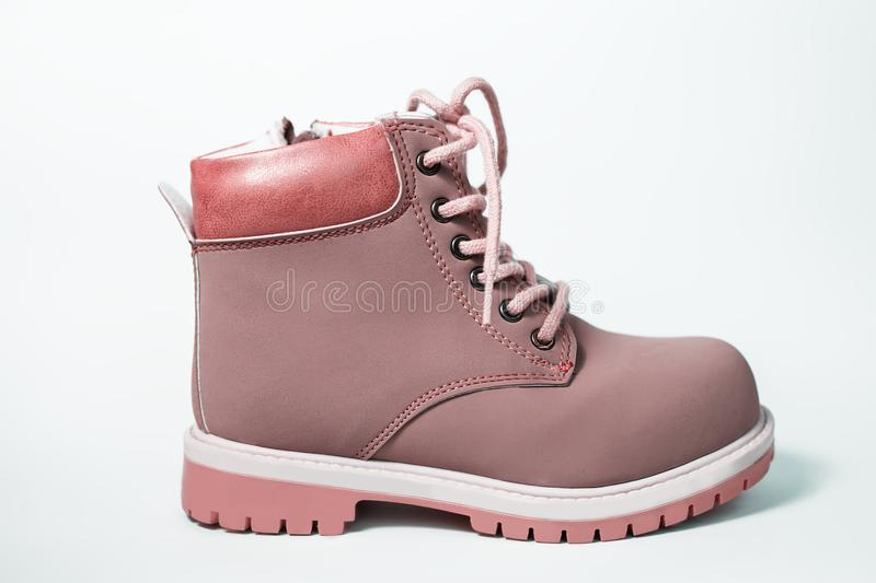 Kid`s fashion pink boots stock photography