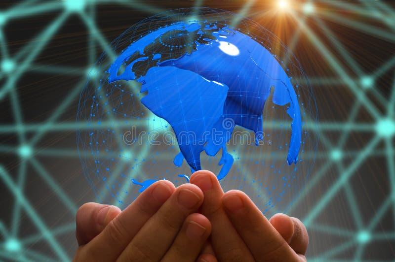 Kid`s hand holding globe in dark background stock photography