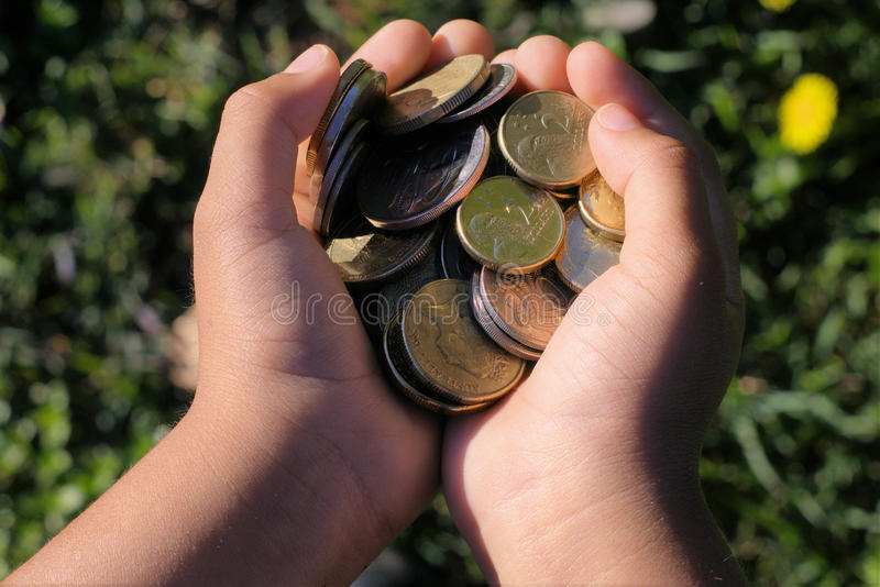 Kid`s hands full of money royalty free stock photo