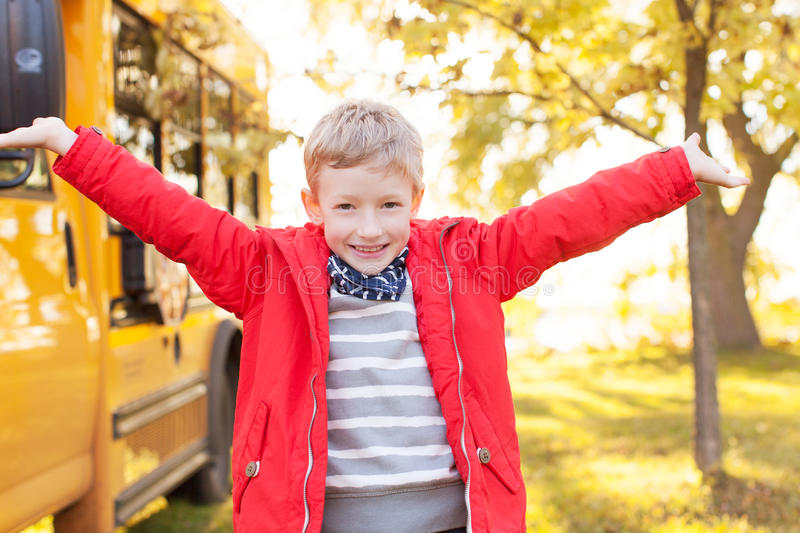 Kid and school bus royalty free stock image