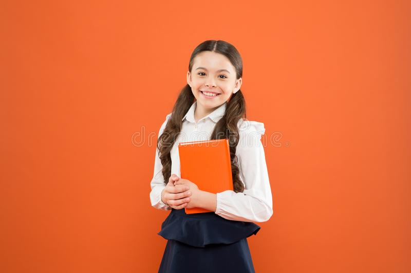 Kid school uniform hold workbook. School lesson. Child doing homework. Believe in possibilities. Inspiration for study royalty free stock photo