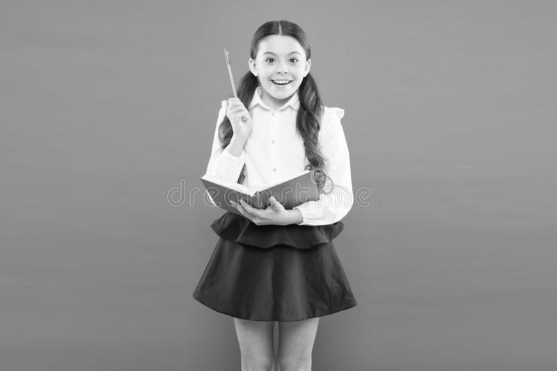 Kid school uniform hold workbook. School lesson. Child doing homework. Your career path begins here. Inspiration for. Study. Back to school. Knowledge day royalty free stock photos