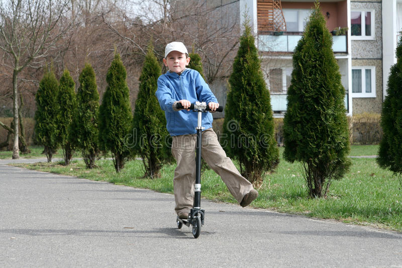 Download Kid and scooter stock image. Image of green, hold, active - 13733611