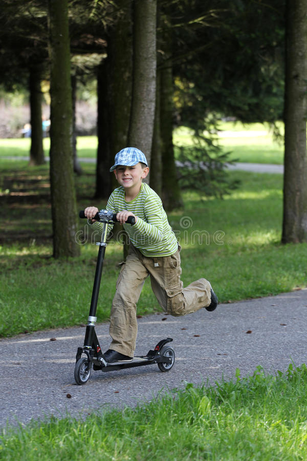 Kid And Scooter Stock Image