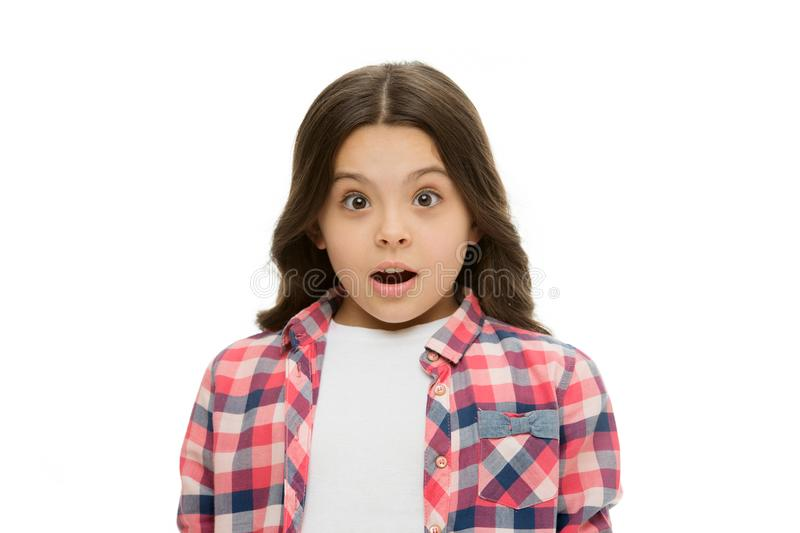 Kid with shocked look isolated on white. Girl with long brunette hair. Little child in casual style. Beauty salon royalty free stock photos