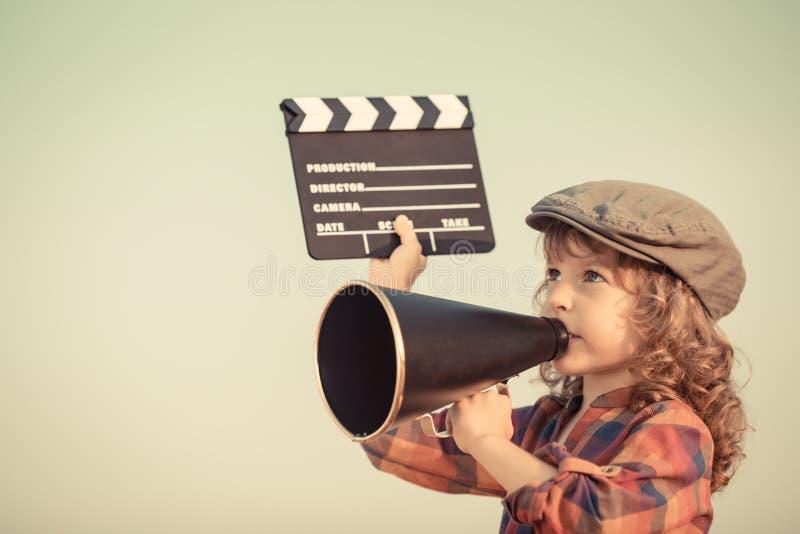 Kid shouting through megaphone royalty free stock image