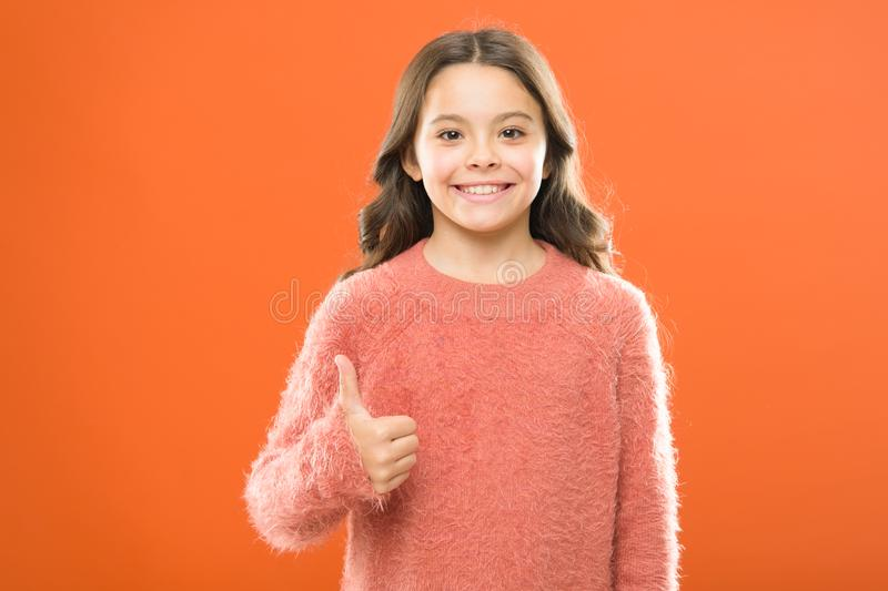 Kid show thumb up. Girl happy highly recommend. High quality product. Satisfied customer. Thumb up means satisfaction. Right choice. Recommendations concept stock photo