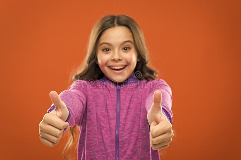 Kid show thumb up. Girl happy totally in love fond of or highly recommend. Thumb up approvement. Girl cute child show. Thumbs up gesture. Gifts your teens will royalty free stock photography