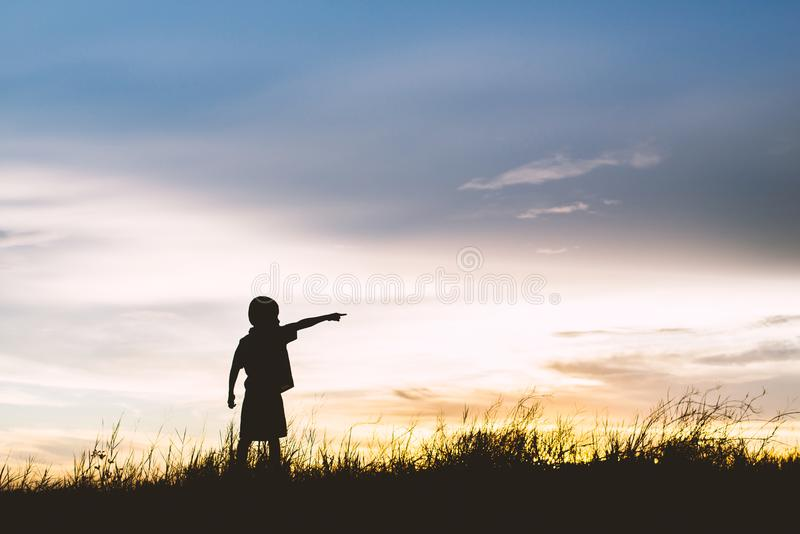 Kid silhouette,Moments of the child`s joy. looking for future, stock photography