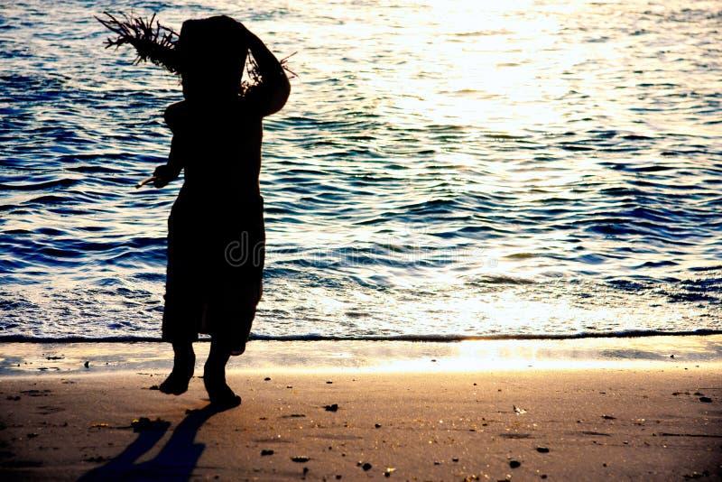Kid silhouette on sea background stock photo