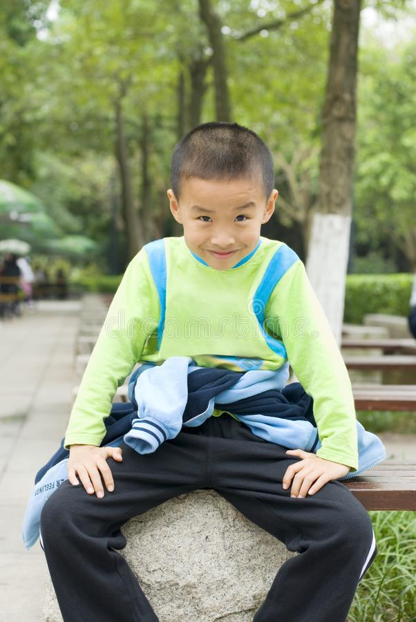 Download A kid sit beside tree stock photo. Image of people, smile - 8940560