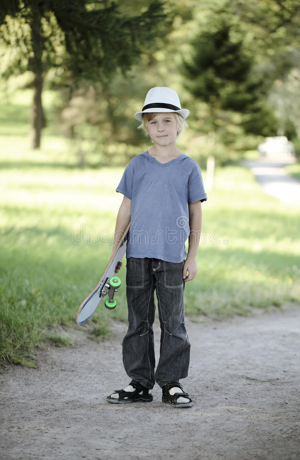 Kid with skateboard stock photo