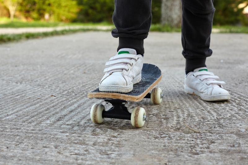 Kid skateboarder doing a skateboard ride. royalty free stock images