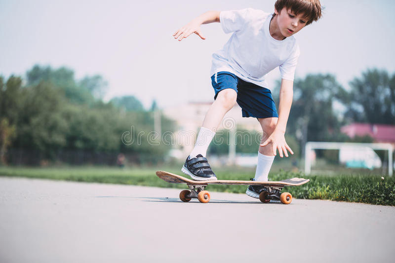 Kid skateboarder. royalty free stock photography