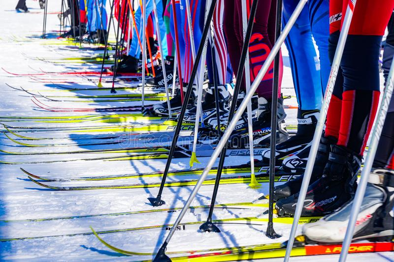 Kid skathlon competitions, a lot of skis before stock images