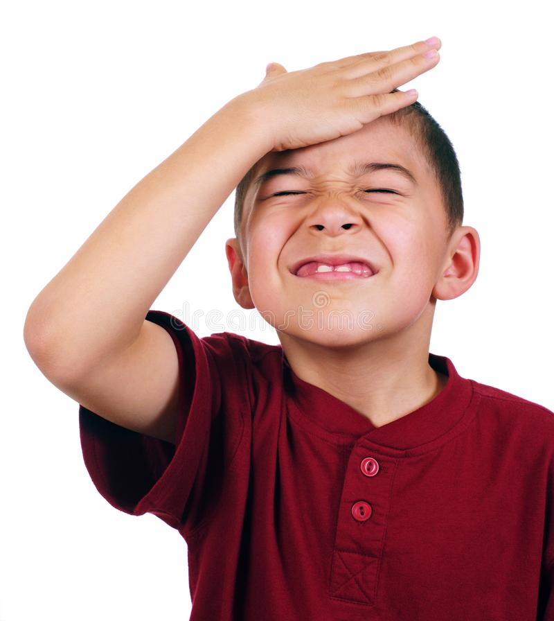 Kid slaps himself on head, oh-no stock image