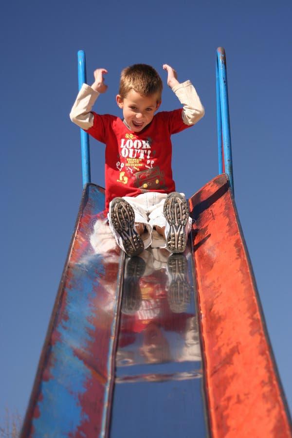 Kid sliding royalty free stock photo