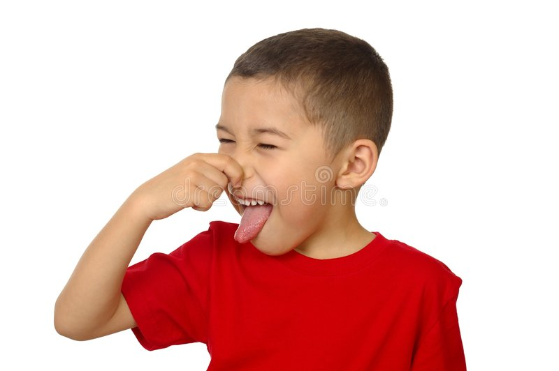 Kid smelling bad odor. Seven year old boy holding his nose as after smelling a bad odor, isolated on white background royalty free stock photos