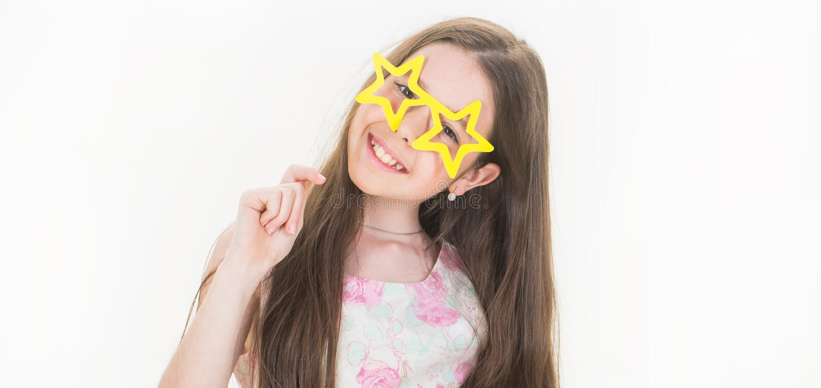 Kid smile. Isolated. Beautiful happy teen. Smile little girl, glasses, preteen. Stylish dress little girl child. Small royalty free stock photos