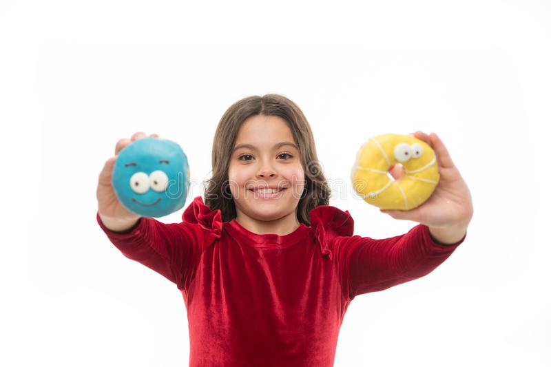 Kid smiling girl ready to bite donut. Sweets shop and bakery concept. Kids huge fans of baked donuts. Can you resist. Fresh made to order donut. Girl hold royalty free stock photography