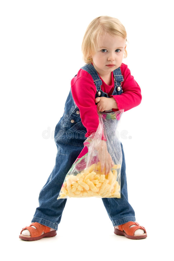 Download Kid with snack stock photo. Image of breakfast, jeans - 20190396