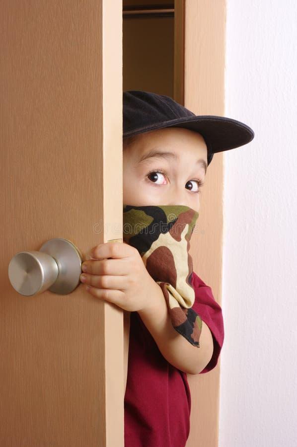 Download Kid sneaking through door stock image. Image of camouflage - 16041909
