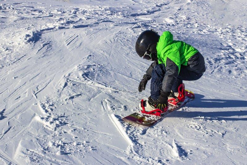 Kid on snowboard in winter sunset nature. Sport photo with edit space. Kid on snowboard in winter sunset nature. Sport photo with edit spac stock photos