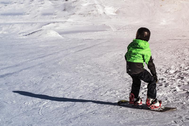Kid on snowboard in winter sunset nature. Sport photo with edit space. Kid on snowboard in winter sunset nature. Sport photo with edit spac royalty free stock photography