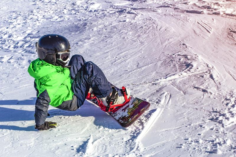 Kid on snowboard in winter sunset nature. Sport photo with edit space. Kid on snowboard in winter sunset nature. Sport photo with edit spac stock photo