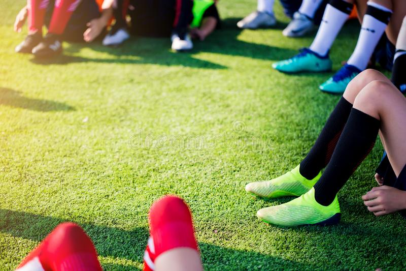 Kid soccer players are sitting with warming on green artificial royalty free stock photo