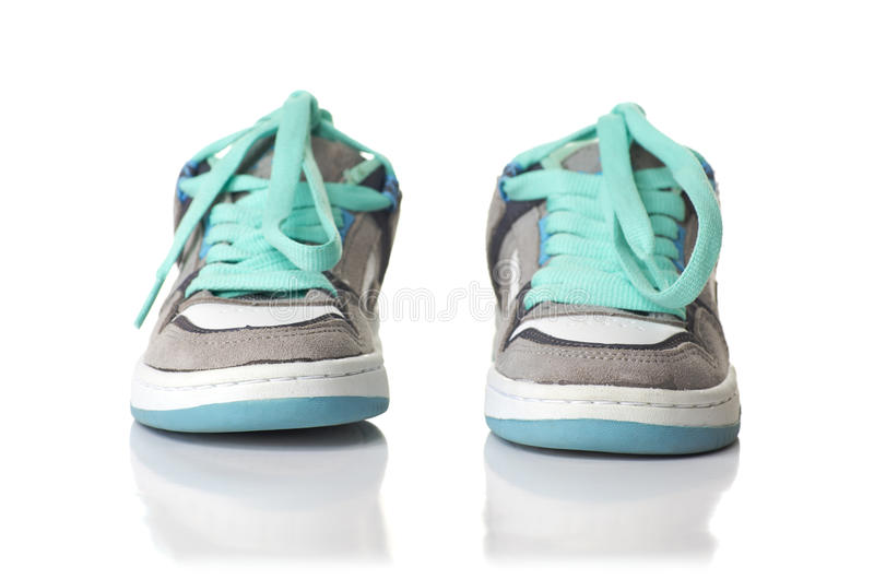 Kid soft shoes. Isolated on white background with reflection royalty free stock photos