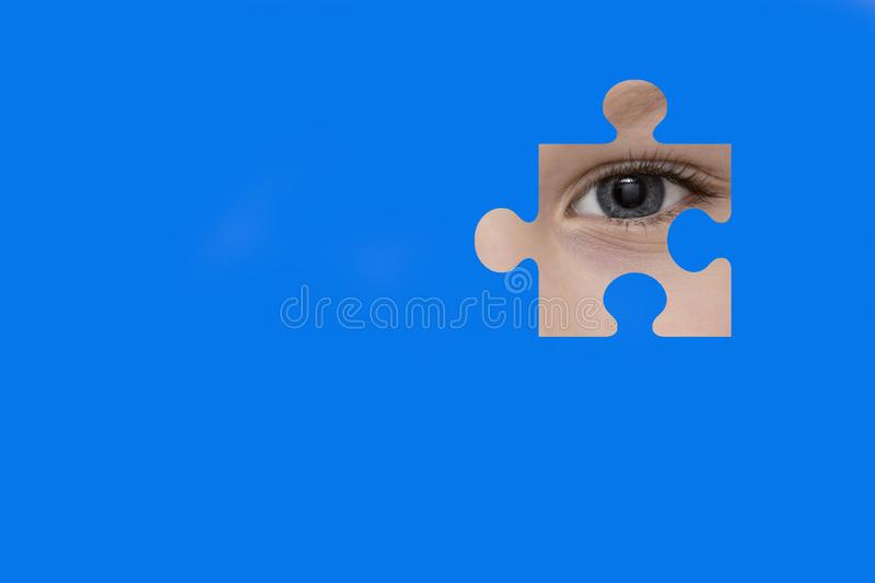 Kid spies through a blue puzzle. Symbol of autism awareness royalty free illustration