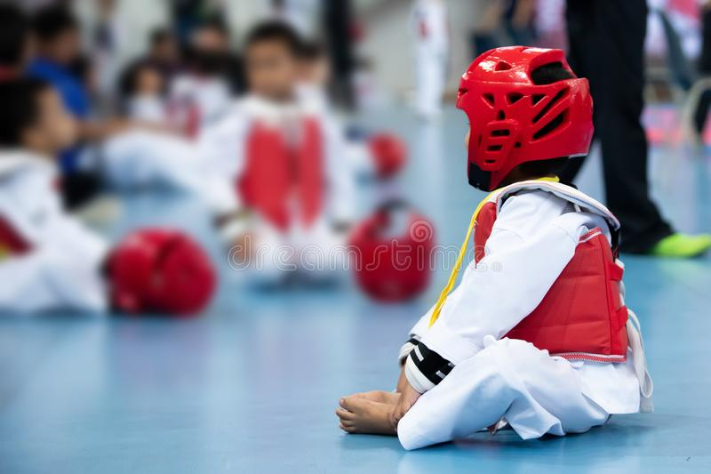 Kid Sport Athlete Taekwondo with protective Gear. Red head vast guard warm up on floor ready to fight for international competition royalty free stock photos