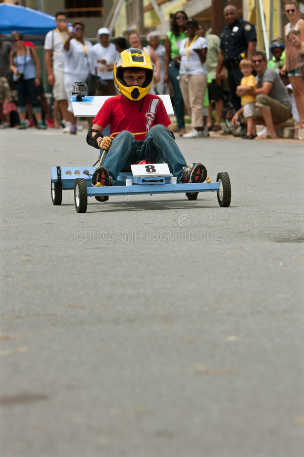 Kid Steers Homemade Car in Atlanta Soap Box Derby Event stock photo
