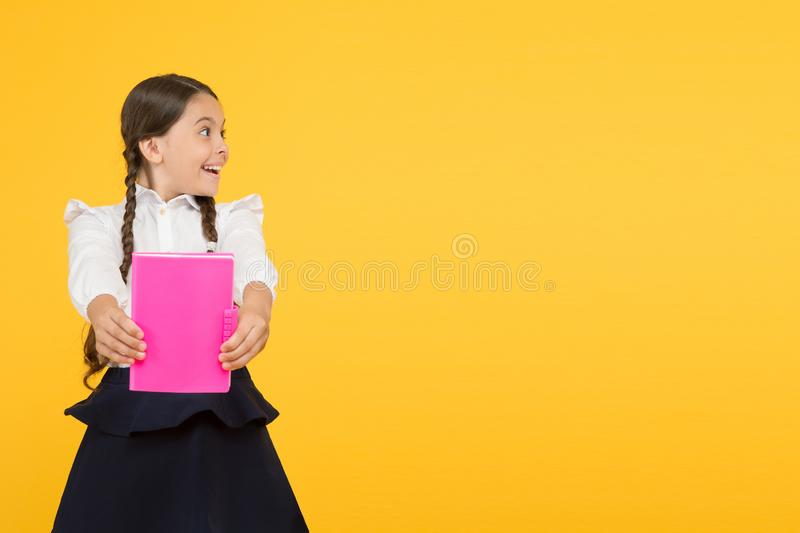 Kid student ready with homework. School girl excellent pupil prepared essay or school project. Raising independence royalty free stock photography