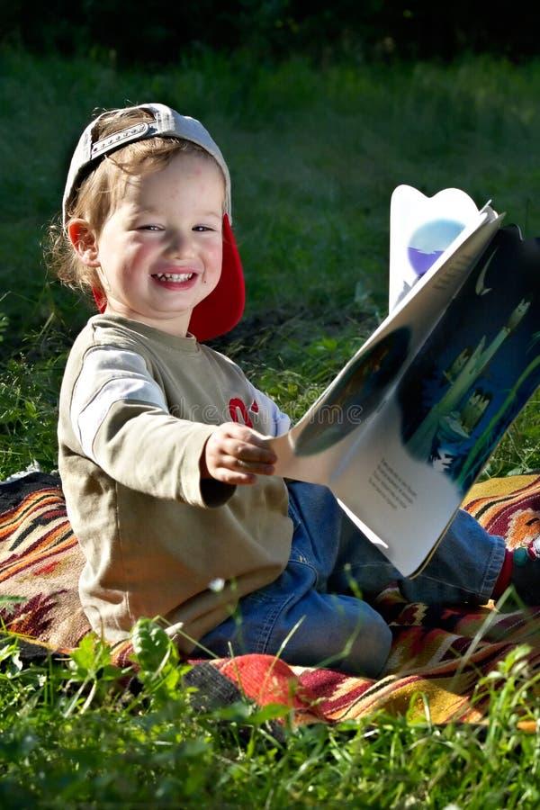 The kid studies to read stock photo