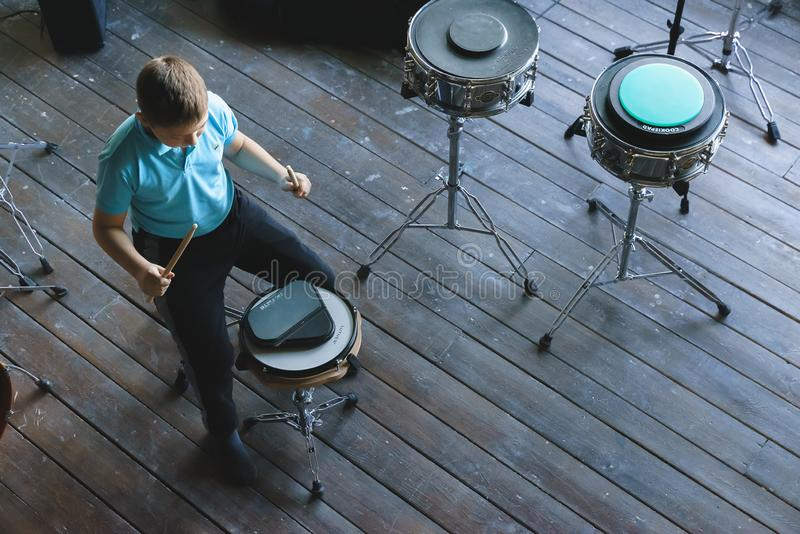 Kid studying drums at school. Training pad royalty free stock photography