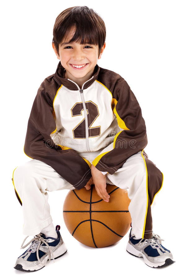 Kid stylishly sitting on the ball. Isolated background stock photos