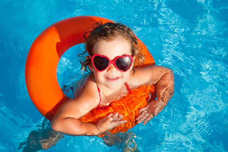 Kid swim in  pool stock images