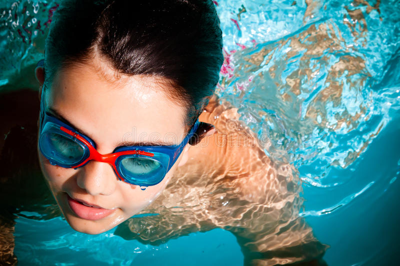 Kid swimming stock photos