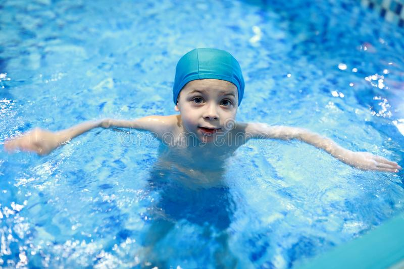 Kid in swimming pool stock image