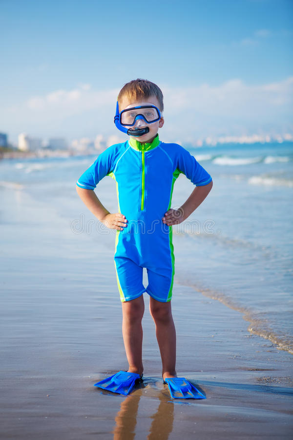 Kid in swimming suit is ready for snorkeling royalty free stock photos